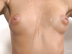 Slender Solo Teen Rubs Oil All Over Her Naked Body
