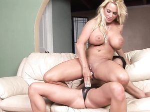 Strap On And A Dildo Action With Busty Lesbians