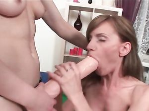 Strap On Pounding For Busty Lesbians' Assholes